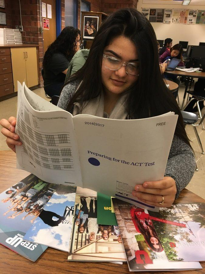Senior Angelica Macias is flipping through the ACT study guide.