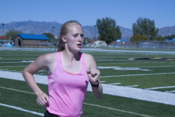 Morgan Taylor practices for cross-country at the school tracks.