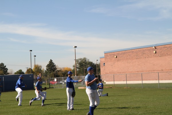 The baseball team participates in after school practice.