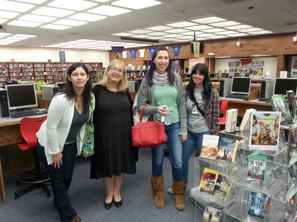 Four of the authors who visited our school pose for a picture in the library.