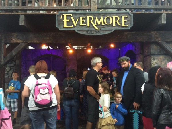 Attendees gather to see the Evermore stand and get a sneak peek of what to expect of the soon to be park that opens in 2015