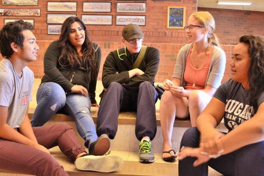 Students of various backgrounds chat as a group without a difference between students who are neurotypical and those who aren't.