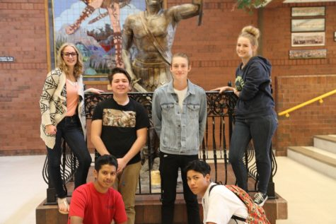 (From the top left to bottom right) Taylor Cherry, Bryan Lozano, Bryson Vincent, Rylee Holt, John Doe, and Sebastian Colderon pose in front of the Taylorsville Warrior statue.