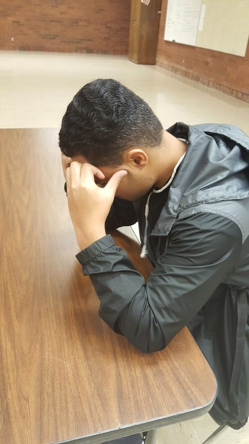 A student sits by himself at school; isolation and feelings of hopelessness are among the main issues suicide prevention resources are trying to address.