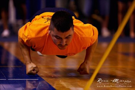 An athlete participates in the knuckle hop competition during the World Eskimo Indian Olympics in Fairbanks, Alaska