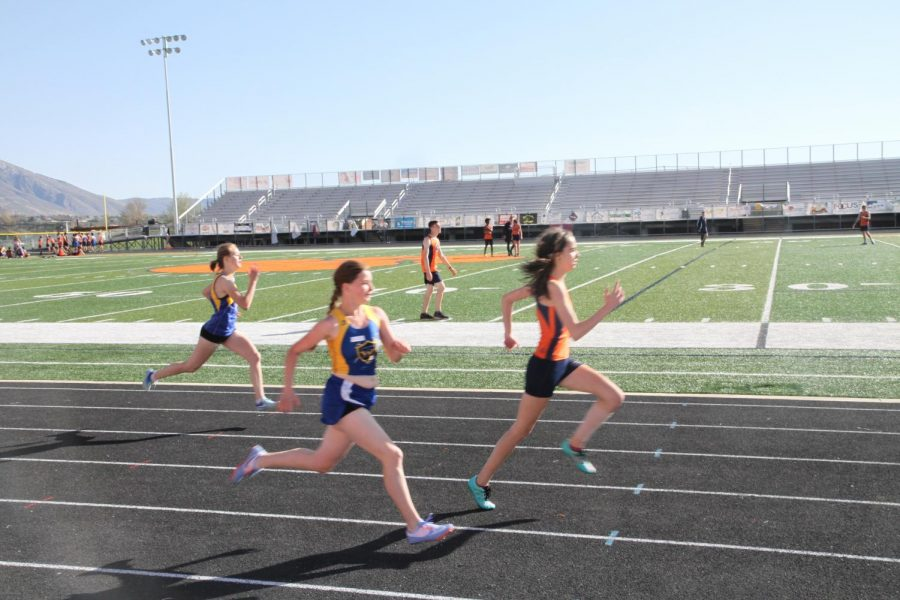 Students on last year's 2016-2017 track team race against Murray High School's track team during a track meet.