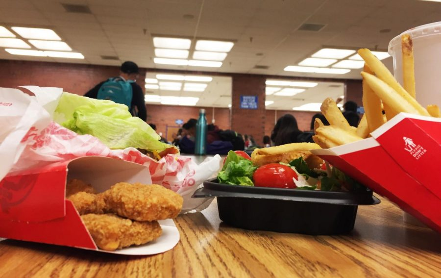 There are many options available for teenager to consume - some healthier than others. This picture depicts the two opposing options, one healthy and the other decidedly not. For students, it's often cheaper to eat fast food over fresh foods.
