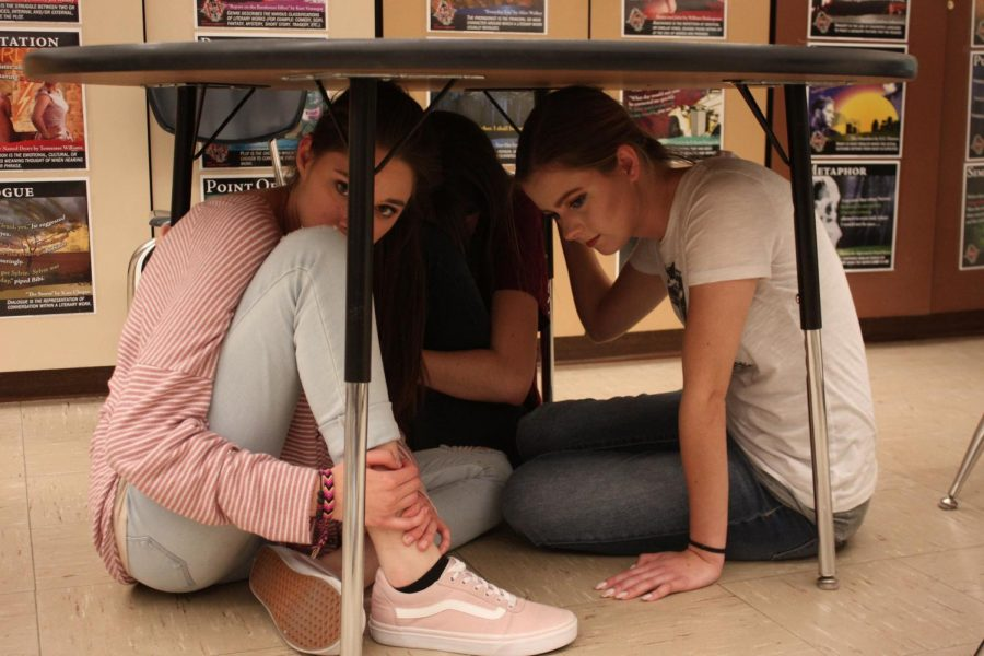 Students+crouch+under+desk+to+simulate+potential+active+shooter+drill.+