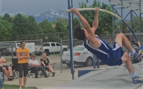 Taylorsville Pole Vaulting team in tryouts. 2018 Senior Pole Vaulter, Jordan Glade, attempts to plant the pole to vault over the bar.