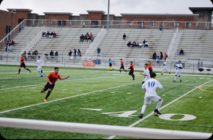 Boys Varsity Soccer going against West High School.
