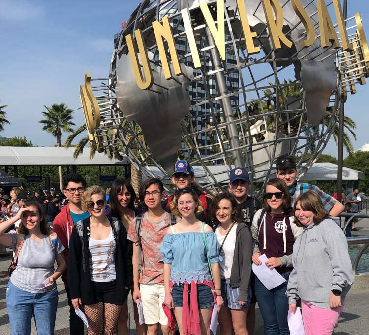A group of music students from the 2017-2018 tour stand outside of Universal Studios