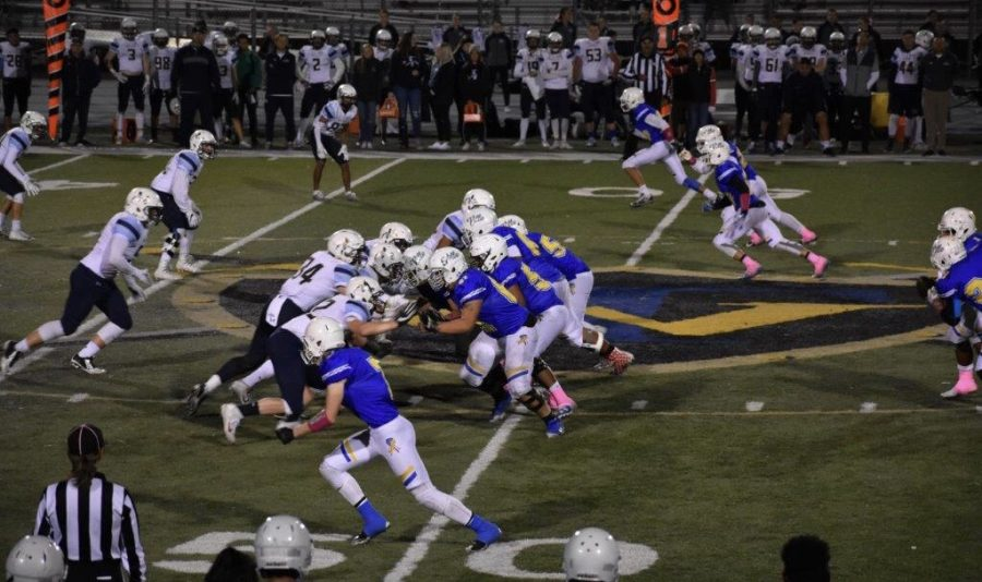 Taylorsville High's football team starting a play.