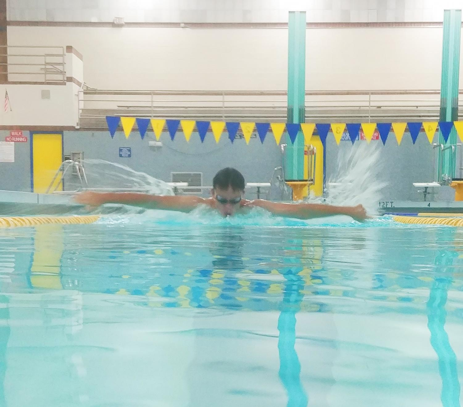 Student Ian Moore, practicing his butterfly stroke during practice after school in the Taylorsville Pool
