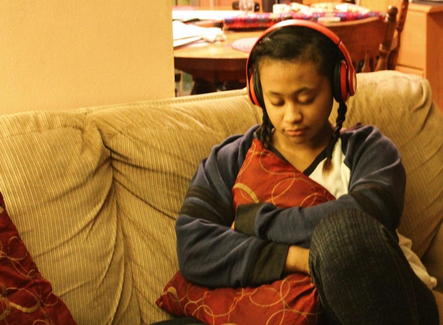 Student Kalia Suapaia is listening to music to calm down at the end of the day.