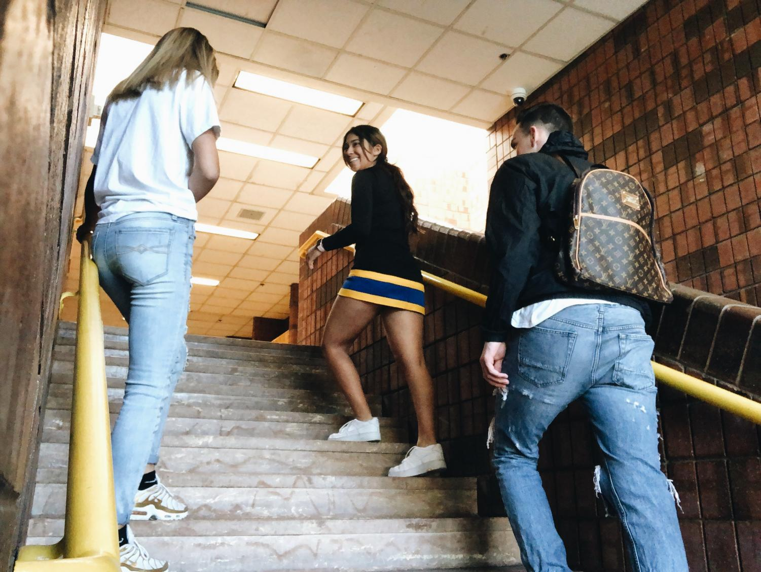 Students walking to class with their different choices of clothing.