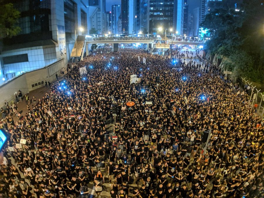 Citizens of Hong Kong standing outside in protest of government.