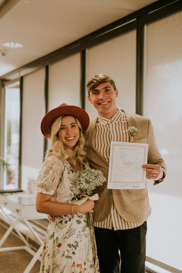 Nicole Lavely with her husband and wedding certificate.