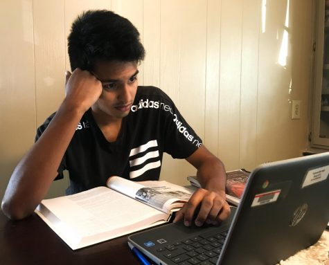 Senior Jose Vasquez works on his schoolwork during the COVID-19 pandemic.