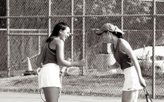 Doubles partners Brooklyn Lee and Athena Lam celebrate after winning a game.